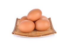 Fresh raw eggs in bamboo basket and on white background Royalty Free Stock Photos