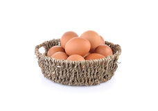 Fresh raw eggs in basket and on white background. Fresh raw eggs in basket and on a white background Royalty Free Stock Photos