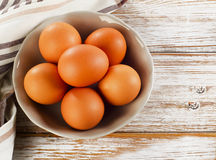 Fresh raw    eggs in a  bowl. Fresh raw   eggs in a bowl. Selective focus Stock Photos