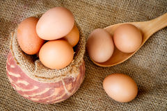 Fresh raw eggs in clay pot Royalty Free Stock Images