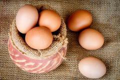 Fresh raw eggs in clay pot Royalty Free Stock Photos