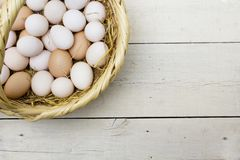 Fresh raw eggs in straw basket royalty free stock images