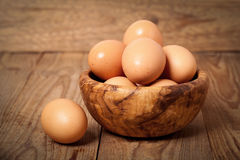 Fresh raw eggs. In the wooden bowl Stock Images