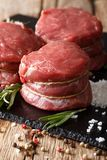 Fresh raw filet mignon steak with ingredients macro. vertical. Fresh raw filet mignon steak with ingredients macro on the table. vertical Royalty Free Stock Images