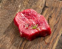 Fresh raw fillet steak. On wooden board Royalty Free Stock Image