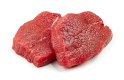 Fresh raw fillet steaks. Isolated on white background Royalty Free Stock Photography