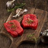 Fresh raw fillet steaks. On wooden cutting board Royalty Free Stock Image