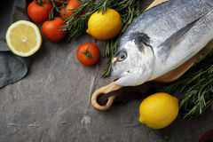 Fresh raw fish on cutting board. Cooking background Royalty Free Stock Photos
