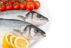 Fresh raw fish on a dish Stock Photos
