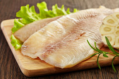 Fresh raw fish fillet. Fresh raw bream fish fillet on wooden cutting board Stock Image