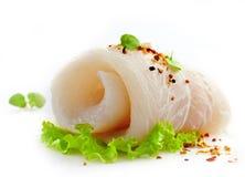 Fresh raw fish fillet. Fresh raw pangasius fish fillet roll Stock Photo
