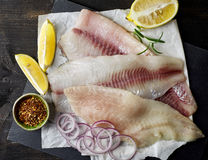 Fresh raw fish fillets. Fresh raw bream and seabass fish fillets, top view Royalty Free Stock Photography