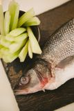 Fresh raw fish. And food ingredients on table Royalty Free Stock Image
