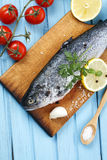 Fresh raw fish and food ingredients on table Royalty Free Stock Photography