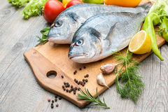 Fresh raw fish gilthead bream. A cutting board Stock Photography