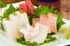 Fresh, raw fish at a sushi restaurant. Beautiful, fresh raw fish at an Asian cuisine sushi restaurant Royalty Free Stock Photography