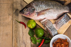 Fresh raw fish on the wood.  Royalty Free Stock Image
