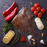 Fresh raw flatfish with ingredients on a slate board closeup. to. Fresh raw flatfish with ingredients on a slate board closeup. view from above Stock Photography