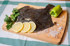 Fresh raw flounder on cutting board Royalty Free Stock Photos