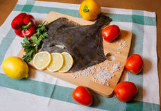 Fresh raw flounder on cutting board Stock Image