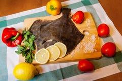 Fresh raw flounder on cutting board Stock Photos