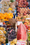 Fresh raw fruits in baskets at street market. Arrangement of ripe fresh raw fruits in wooden boxes, plastic baskets at open street farmer's market Royalty Free Stock Photos