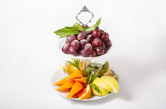 Fresh raw fruits. Sliced and served on a white plate Royalty Free Stock Images