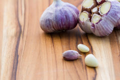Fresh raw garlic. Close up of garden fresh raw garlic on a wooden cutting board Stock Photo