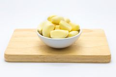 Fresh raw garlic on wooden board. White background Stock Photo