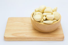 Fresh raw garlic on wooden bowl. On white background Royalty Free Stock Photography