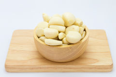 Fresh raw garlic on wooden cup. On white background Royalty Free Stock Image