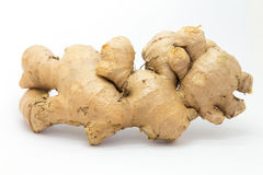 Fresh raw ginger on White background. Natural food background Royalty Free Stock Images