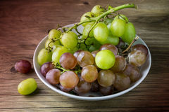 Fresh raw grape on wooden table. Closeup Royalty Free Stock Photography