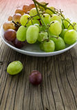 Fresh raw grape on wooden table. Closeup Stock Photos