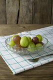 Fresh raw grape on wooden table. Closeup Stock Photo