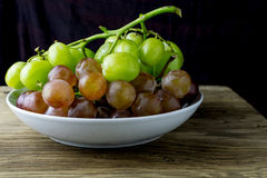 Fresh raw grape on wooden table. Fruit Stock Images