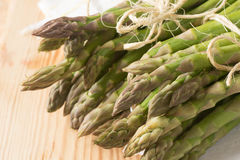 Fresh raw green asparagus. Closeup to fresh raw green asparagus Royalty Free Stock Image