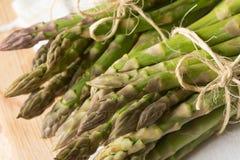 Fresh raw green asparagus. Closeup to fresh raw green asparagus Stock Photo
