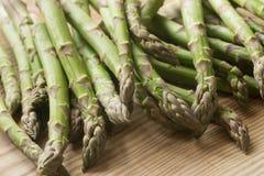 Fresh raw green asparagus. Closeup to fresh raw green asparagus Stock Images