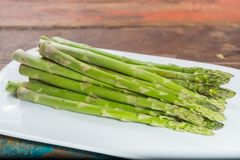 Fresh raw green asparagus ready to cook. Close up Royalty Free Stock Photos