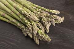 Fresh raw green asparagus. On a wooden table Royalty Free Stock Image