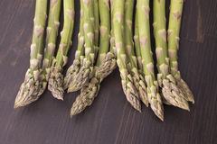 Fresh raw green asparagus. On a wooden table Stock Image