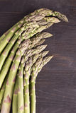 Fresh raw green asparagus. On a wooden table Royalty Free Stock Images