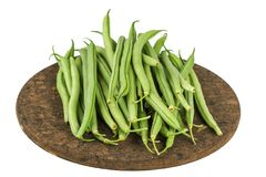 Fresh raw green beans on board isolated on white. Fresh raw green beans on board isolated on a white Stock Image