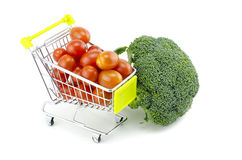 Fresh raw green broccoli, cherry tomatoes on trolley. Isolated on white background Royalty Free Stock Photo