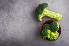 Fresh raw green broccoli. On a table. Diet healthy product. Top view Stock Photography