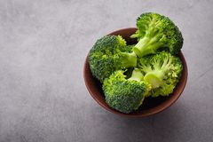 Fresh raw green broccoli. On a table. Diet healthy product Royalty Free Stock Photos