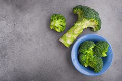 Fresh raw green broccoli. On a table. Diet healthy product. Top view Royalty Free Stock Photography