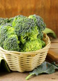 Fresh raw green cabbage broccoli. In a wicker basket Stock Images