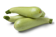 Fresh raw green courgettes. On white background Stock Images